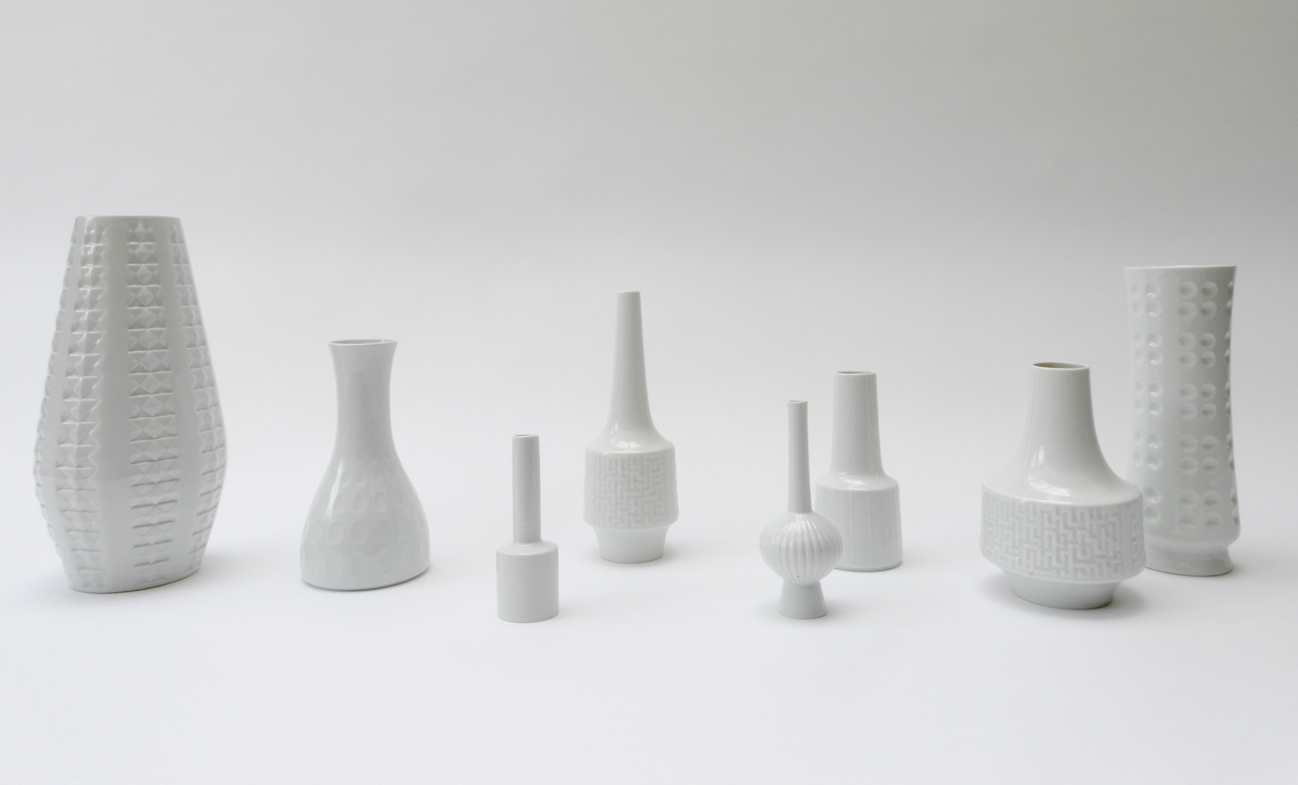 Sold - Set of 8 German White Ceramic Vases